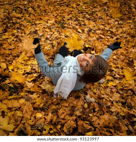 portrait of a beautiful girl on the background of the autumn yellow leaves