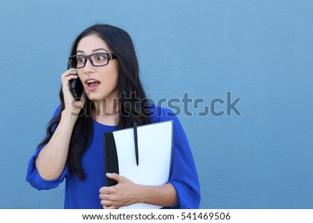 Portrait of a beautiful girl on the phone while getting shocking or surprising news #541469506