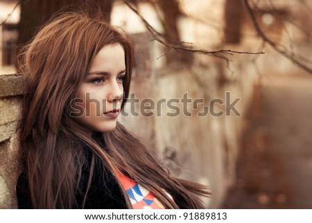 portrait of a beautiful girl on the street. photo with warm colors