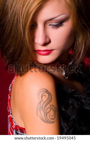 Portrait of a beautiful girl over red background
