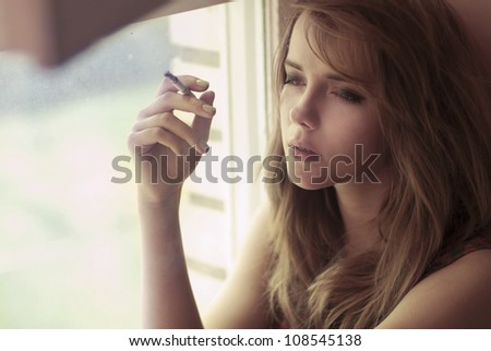 portrait of a beautiful girl smoking
