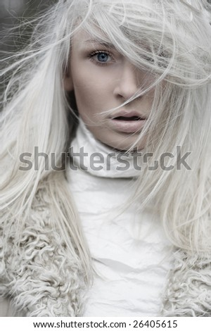 Portrait of a beautiful girl wearing white fur