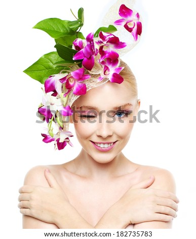 Portrait of a beautiful girl with a wreath of orchids on the head