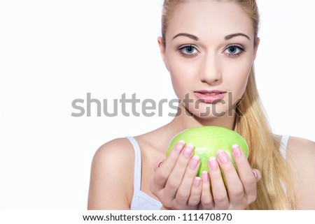 Portrait of a beautiful girl with apple
