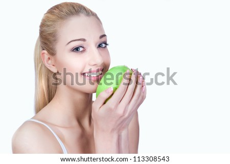 Portrait of a beautiful girl with apple - stock photo