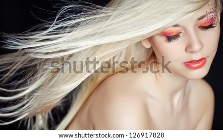 Portrait of a beautiful girl with flying blond hair