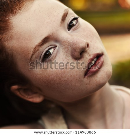 portrait of a beautiful girl with freckles, close-up