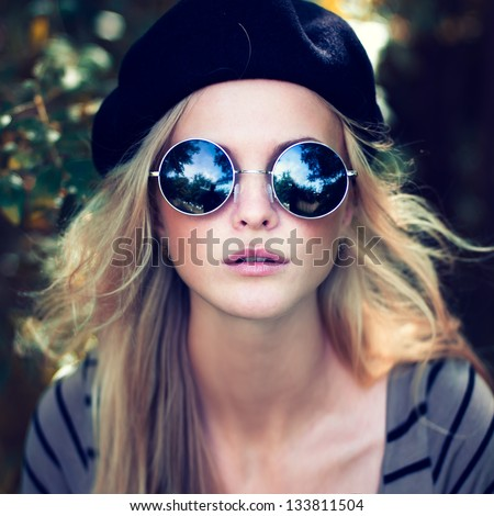 portrait of a beautiful girl with glasses