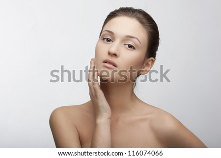 portrait of a beautiful girl with perfect skin