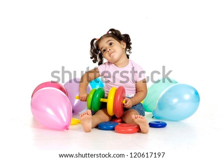 portrait of a beautiful girl with toy on a white