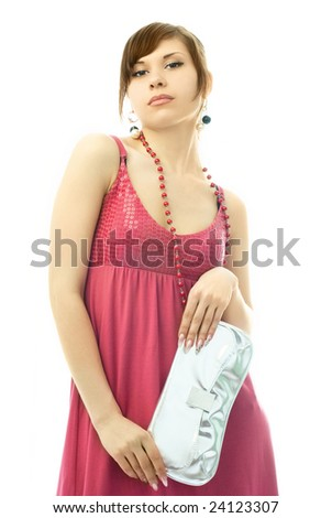 portrait of a beautiful glamorous lady with a silver clutch