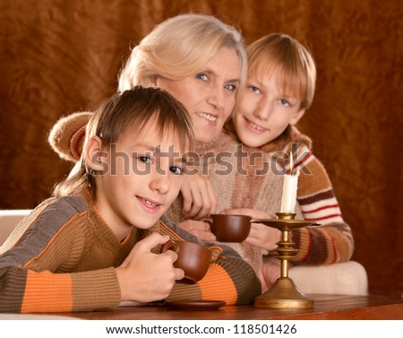 portrait of a beautiful happy family posing on a brown