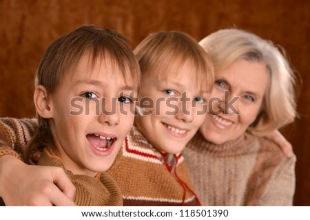 portrait of a beautiful happy family posing on a brown background
