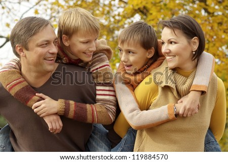 portrait of a beautiful happy family relaxing in autumn