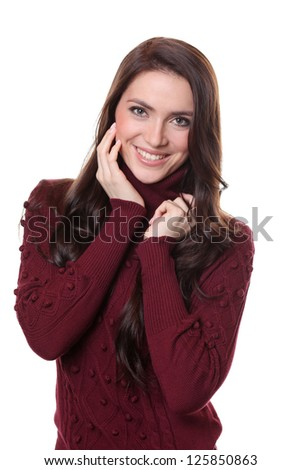 portrait of a beautiful happy woman in a knitted jacket