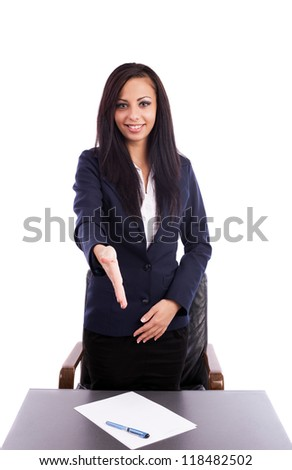 Portrait of a beautiful hispanic businesswoman giving hand for handshake isolated on white background