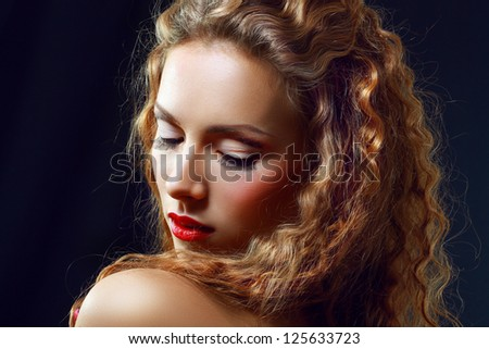 Portrait of a Beautiful Hot Girl With Long Curly Red Hair