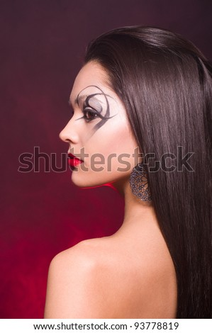 Portrait of a beautiful lady with art makeup