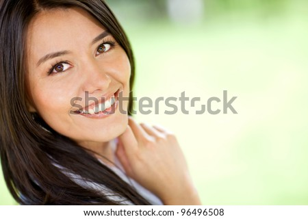 Portrait of a beautiful Latin woman smiling - outdoors