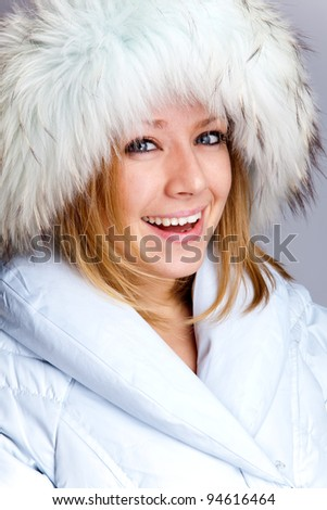 Portrait of a beautiful laughing woman in the white fur coat #94616464