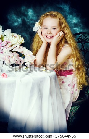 Portrait of a beautiful little angelic girl smiling at camera. Vintage background.