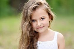 portrait of a beautiful little girl in summer