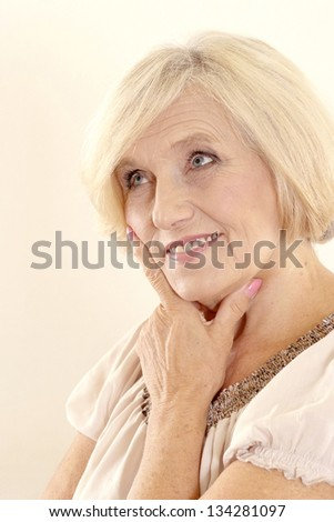 Portrait of a beautiful mature woman on a light background stock