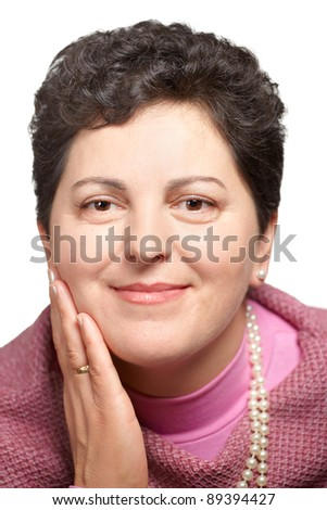 Portrait of a beautiful middle aged woman against a white background.