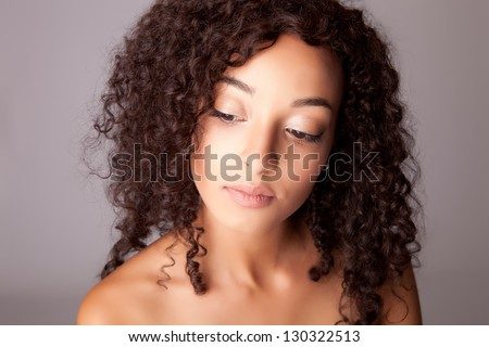 Portrait of a beautiful mix race woman over white background
