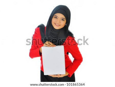 Portrait of a beautiful Muslim woman holding a white paper, isolated on white background
