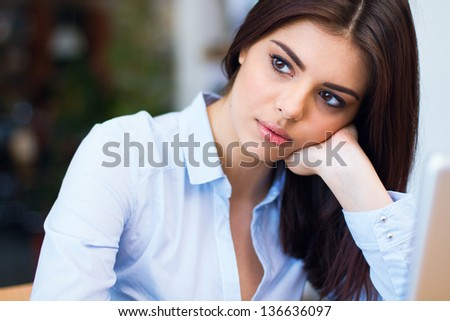 Portrait of a beautiful pensive businesswoman looking away