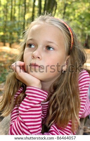 portrait of a beautiful pensive girl