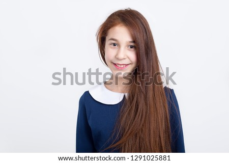 Portrait of a beautiful red-haired girl on a light background. Stock photo ©