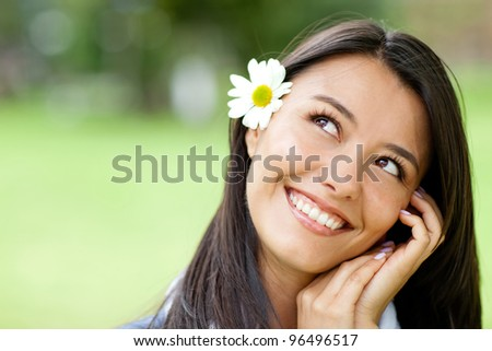 Portrait of a beautiful romantic pensive woman smiling