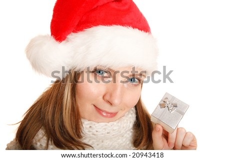 Portrait of a beautiful Santa girl with a gift box