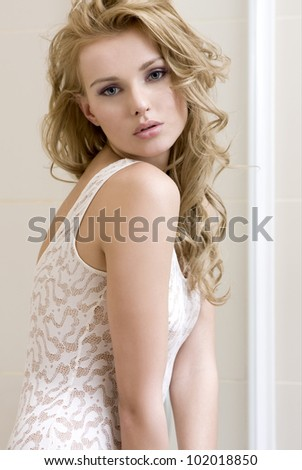 Portrait of a beautiful sensuality young woman with long blonde hair - stock photo