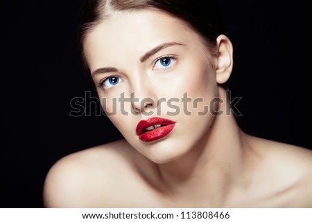 Portrait of a beautiful sexy brunette girl with red lips