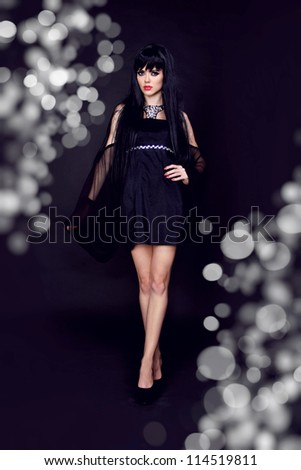 Portrait of a beautiful sexy young woman in black dress