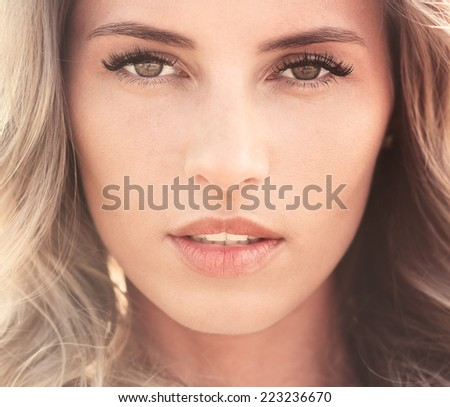 portrait of a beautiful sexy young woman with perfect skin and make-up closeup