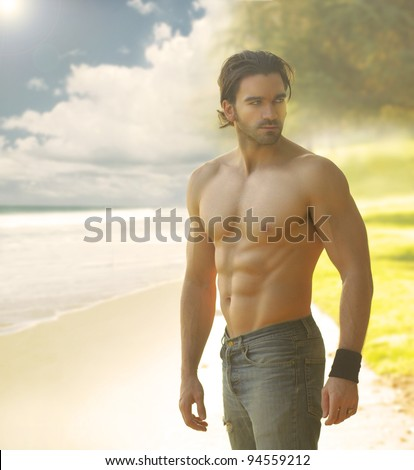 Portrait of a beautiful shirtless man in jeans against the light with a classic retro feeling