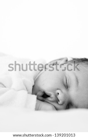 Portrait of a beautiful sleeping baby on white
