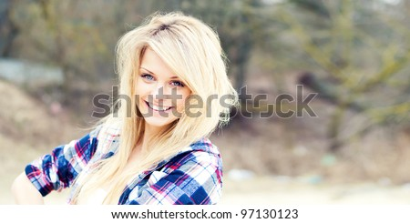 portrait of a beautiful smiling blonde