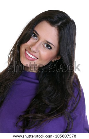 portrait of a beautiful smiling brunette on white background