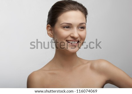 portrait of a beautiful smiling girl with perfect skin - stock photo
