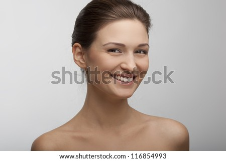 portrait of a beautiful smiling girl with perfect skin