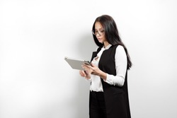 Portrait of a beautiful smiling woman blonde with a tablet in her hands in a business suit and jacket on a white background. A student or a businesswoman works, uses network and computer technology.
