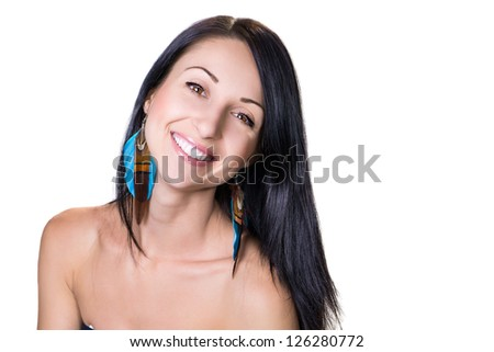 Portrait of a beautiful smiling woman in bright earrings