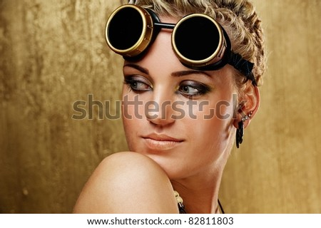 Portrait of a beautiful steam punk girl.