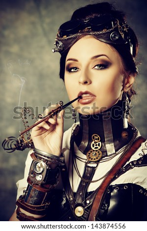 Portrait of a beautiful steampunk woman over grunge background