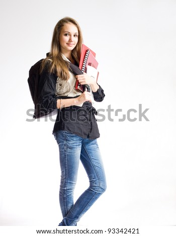 Portrait of a beautiful student girl with black backpack and books.